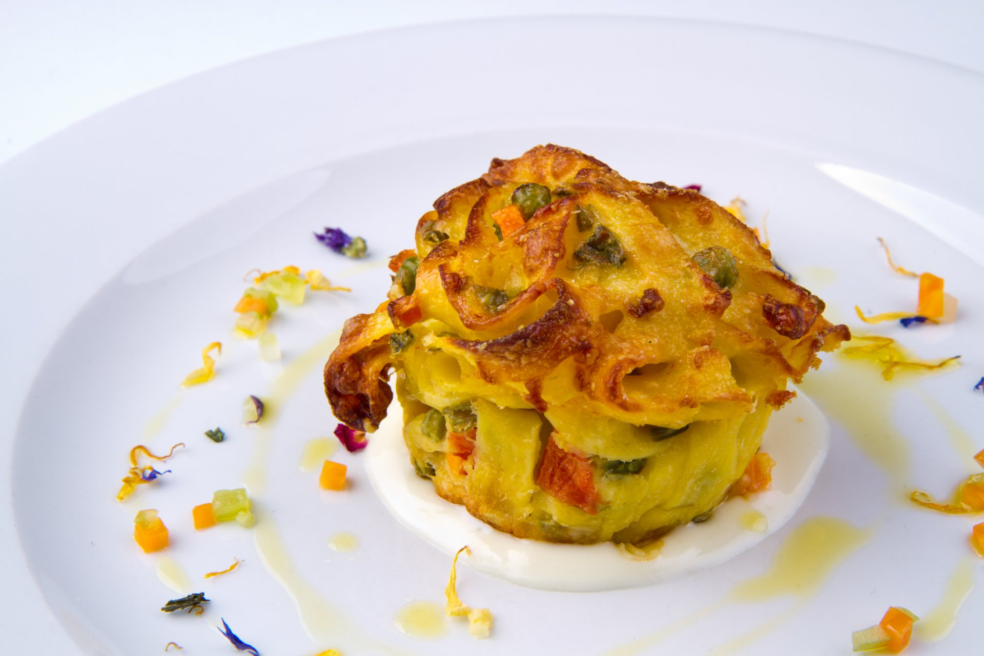 Tagliatelle, spring vegetable and stracchino cheese timbale - Enyo